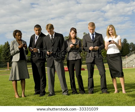 Business Group On Phones standing