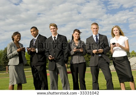 Business Group On Phones standing - stock photo