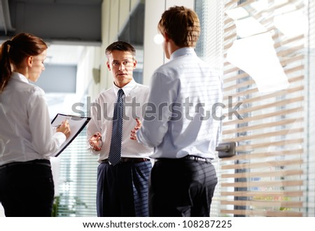 Business group quickly make changes in their pal before meeting with partners - stock photo