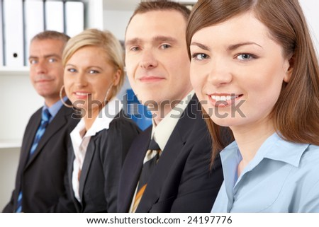 Business group sitting in row