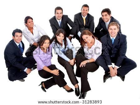 Business group sitting on the floor isolated over white