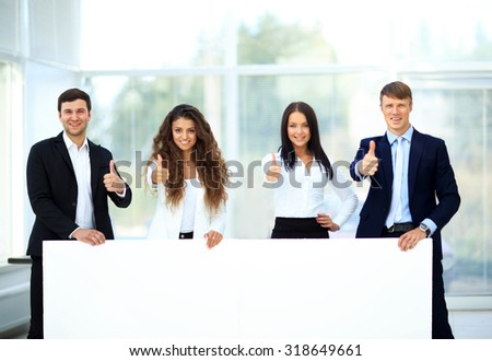 Business group with banner in office - stock photo
