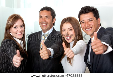 business group with thumbs-up at the office - stock photo