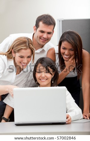 Business group working with laptop at the office - stock photo