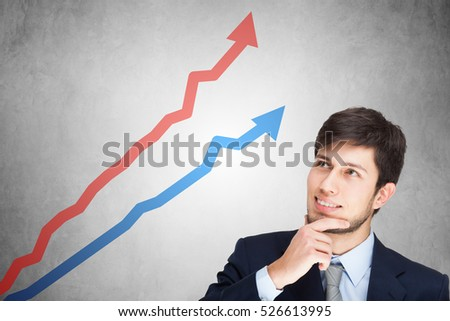 Business growth concept, man looking at a positive graph