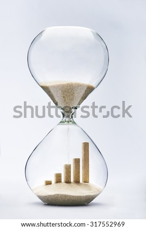 Business growth graphic bar made out of falling sand inside hourglass
