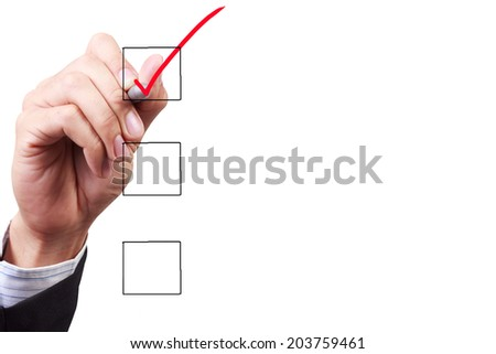 business hand checking the checklist boxes somthing with pen on transparent glass  - stock photo