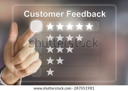 business hand clicking customer feedback on virtual screen interface - stock photo