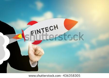 business hand clicking fintech or financial technology flat design rocket - stock photo