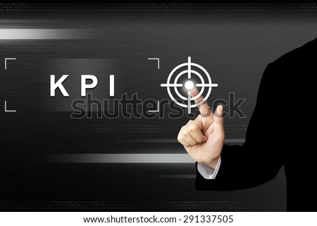 business hand clicking key performance indicator or KPI button on a touch screen interface - stock photo