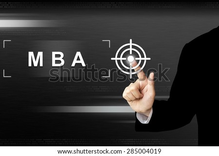 business hand clicking mba or Master of Business Administration button on a touch screen interface - stock photo