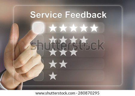 business hand clicking service feedback on virtual screen interface - stock photo