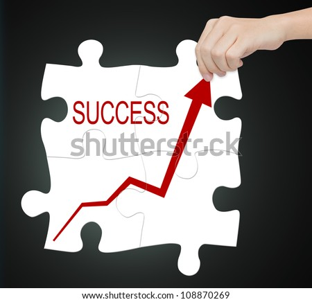 business hand connect success graph on jigsaw puzzle - stock photo
