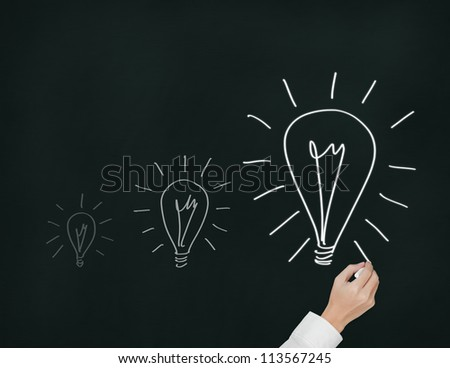 business hand drawing growth light bulb or growth idea concept - stock photo