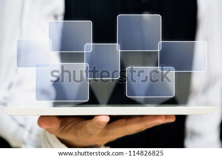 Business hand hold touch screen tablet computer and buttons - stock photo