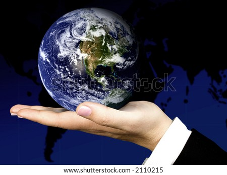 business hand holding a globe with the world map in the background - stock photo