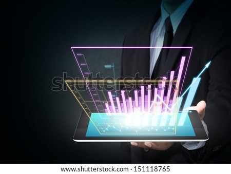 Business hand holding chart on tablet - stock photo