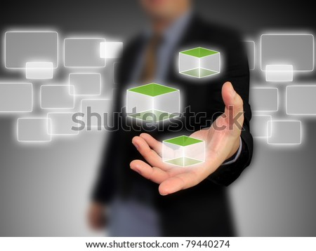 Business hand holding cubic