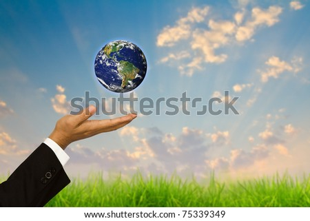 Business hand holding globe - stock photo