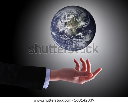business hand holding globe (Collage images from www.nasa.gov) - stock photo