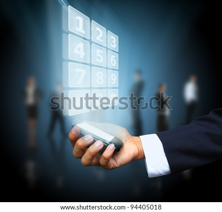 Business hand holding mobile phone - stock photo