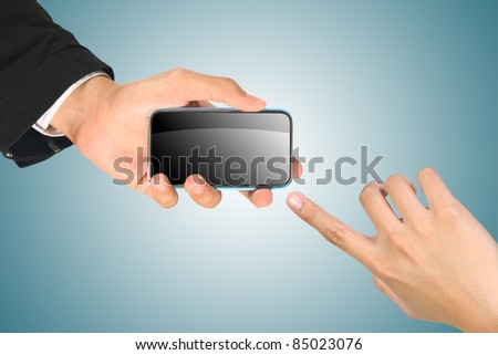 Business Hand holding smart phone on blue - stock photo