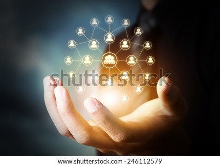 Business hand holding virtual icon of social network - stock photo