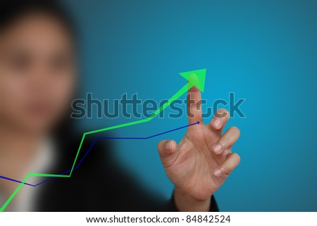 business hand point at up trend graph