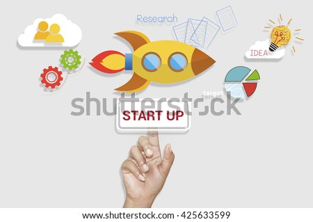 Business Hand pointing button start up business launch to success concept on virtual screen background..