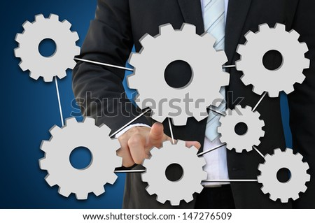 Business hand pointing gear for working system of business concept - stock photo