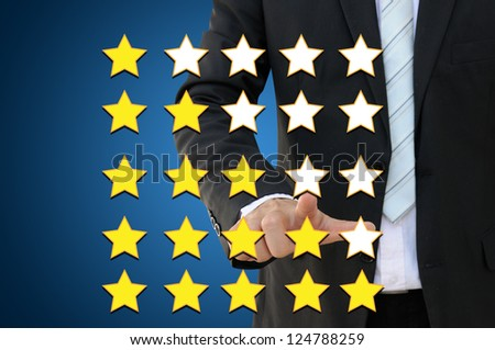 Business hand pointing performance evaluation in rating concept - stock photo