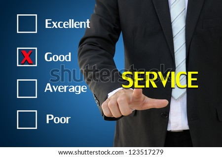 Business hand pointing service of questionnaire for good concept - stock photo