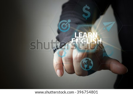 business hand pressing  interface and select LEARN ENGLISH button , business concept , business idea , strategy concept