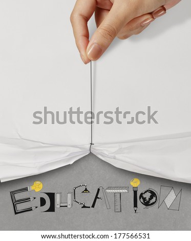 business hand pull rope open wrinkled paper show EDUCATION design text as concept - stock photo
