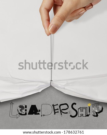 business hand pull rope open wrinkled paper show LEADERSHIP design text as concept - stock photo