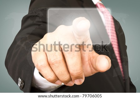 Business hand pushing a button on a touch screen interface - stock photo