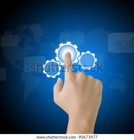 business hand pushing button with touch screen interface - stock photo