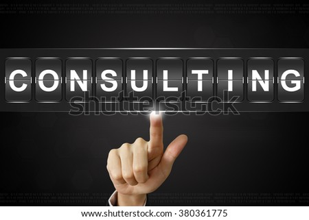 business hand pushing consulting on Flipboard Display - stock photo