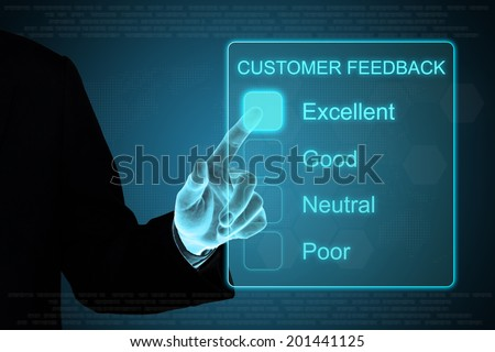 business hand pushing customer feedback on a touch screen interface  - stock photo