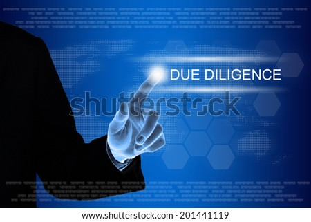 business hand pushing due diligence button on a touch screen interface  - stock photo