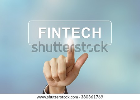 business hand pushing fintech or Financial technology button on blurred background - stock photo