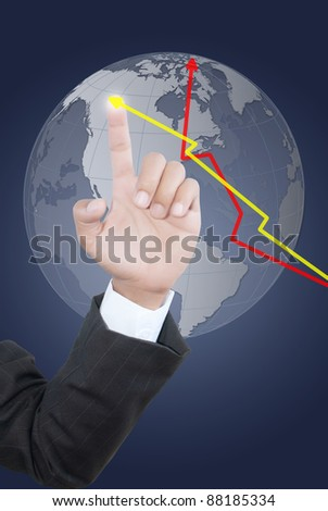 Business hand pushing graph and globe.