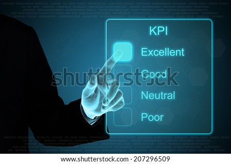 business hand pushing KPI on a touch screen interface  - stock photo
