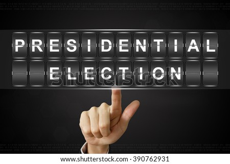business hand pushing presidential election on Flipboard Display - stock photo