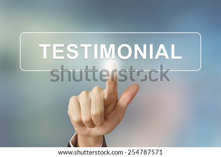 business hand pushing testimonial button on blurred background - stock photo