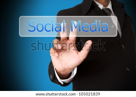 business hand pushing the social media  virtual button as concept