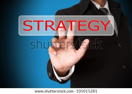 business hand pushing the strategy virtual button as concept