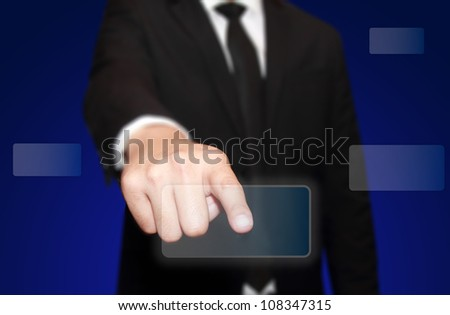 business hand pushing the virtual touch screen interface - stock photo