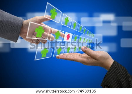 Business Hand select New Employee from Electronic interface using for Business Recruitment and Workforce Concept - stock photo