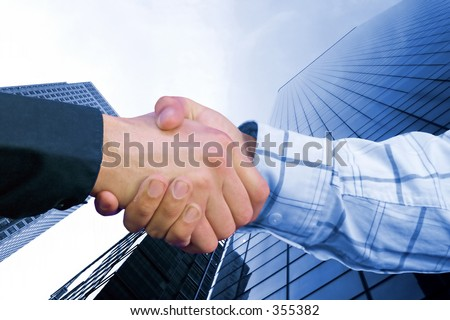 business hand shake deal in colour with a toned background to match colours family of sleeves - stock photo